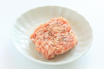 A small bowl of raw ground chicken